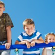 Three kids climbing up — Stock Photo