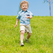 Joyful kid running — Stock Photo