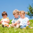 Kids sit on grass — Stock Photo #8691648