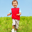 Stok fotoğraf: Laughing boy running