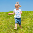 Foto Stock: Little girl running