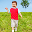 Stock Photo: Exciting kid running