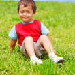 Boy sitting on grass — Photo #8691723