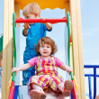 Stock Photo: Toddlers on chute