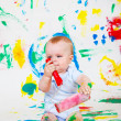 Playful baby painting - Stock Photo