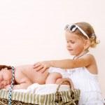 Toddler girl and newborn baby — Stock Photo #8691997