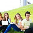 Teens with laptops — Stock Photo