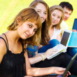 Teenagers with laptops — Stock Photo