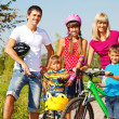 Stock Photo: Active parents and kids