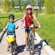 Kids riding bikes in park — Stock Photo