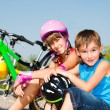 Boy and his sister in protective cycling helmets — Stock Photo