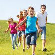 Happy family running — Stock Photo #8692514