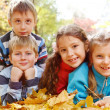 Girls and boys in autumnal park — Stockfoto