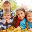Girls and boys in autumnal park — Stok fotoğraf