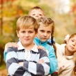 Stock Photo: Boys and girls in autumn