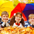 Children under umbrellas — Stock Photo