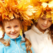 Girls wearing autumnal head wreaths — Stock Photo