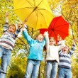 Group of kids with umbrellas — Stock Photo