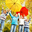 Stock Photo: Group of kids with umbrellas