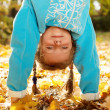 Girl standing upside down — Stock Photo