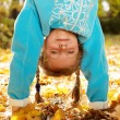 Stock Photo: Girl standing upside down