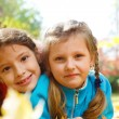 Little girls in  park - Stock Photo