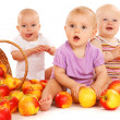 Babies eating apples — Stock Photo