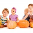 Friends playing with pumpkins — Stock Photo