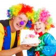 Clowns with a cake — Stock Photo