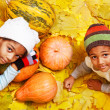 Stock Photo: Brother and sister with autumnal harvest
