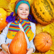 Stock Photo: Smiling girl with pumpkin