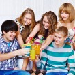 Teenagers clinking glasses — Stock Photo #8694459