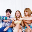 Teenagers eating popcorn — Stock Photo