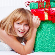 Teenage girl with presents — Stock Photo