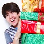 Boy holding presents — Stock Photo