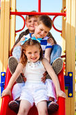 Friends on the playground slide — Stock Photo