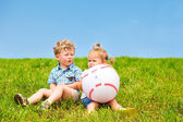 Two friends sitting on grass — Stock Photo