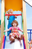 Toddlers on a chute — Stock Photo
