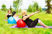 Pregnant women doing aerobics — Stock Photo