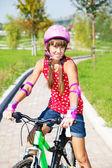 Girl in protective helmet — Stock Photo