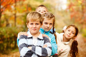 Boys and girls in autumn — Stock Photo