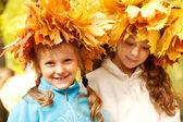 Girls wearing autumnal head wreaths — Stock Photo