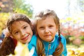 Little girls in park — Stock Photo