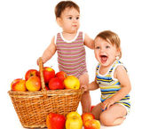 Toddlers with fruit basket — Stock Photo