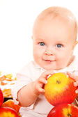 Baby holding apples in hands — Stock Photo