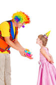 Clown giving presents — Stock Photo