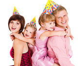 Family in party hats — Foto Stock