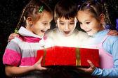 Kids with Christmas gift — Stock Photo