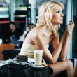 Stock Photo: Sexy woman at a restaurant