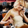 Perfect blonde beauty calling someone on a lunch break — Stock Photo